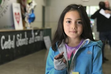 Central Unified student shows off her new winter coat