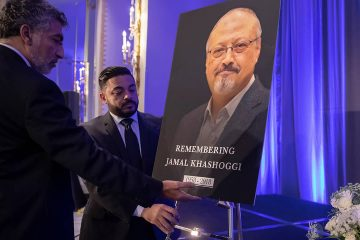 Photo of Ahmed Bedier setting up an image of Jamal Khashoggi