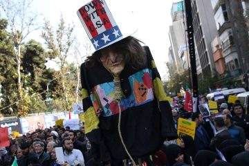 "Photo of ""Uncle Sam"" being held up by demonstrators during a rally in Iran"