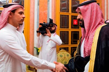 Photo of Crown Prince Mohammed bin Salman, right, shaking hands with Salah Khashoggi, son of Jamal Khashoggi