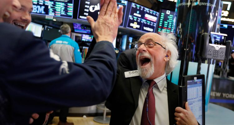 Photo of Wall Street floor traders exchanging high-fives