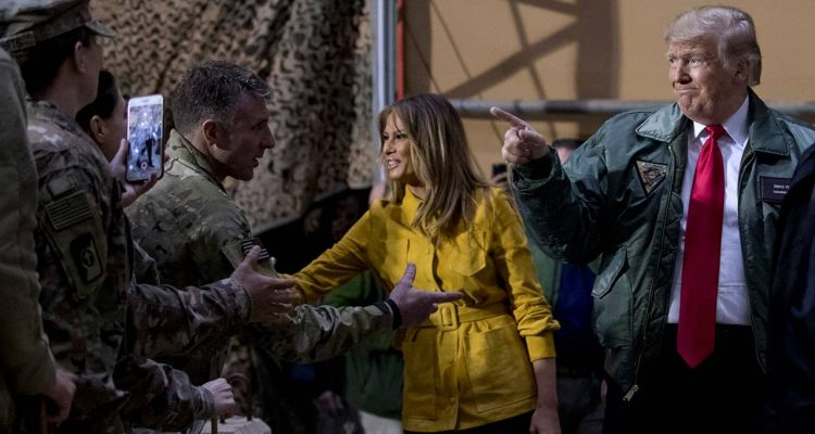 Photo of President Donald Trump and Melania Trump getting US troops in Iraq