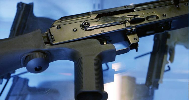Photo of a bump stock attached to a semi-automatic rifle