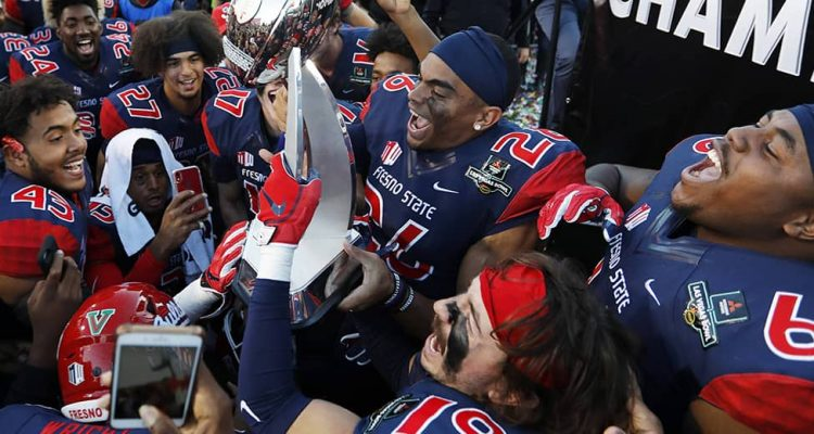 Photo of Fresno State football team celebrating after their win