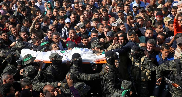 Photo of mourners carrying the body of Nour Baraka