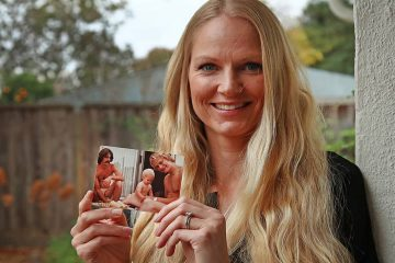 Photo of Diana Sauer holding a photo of her father