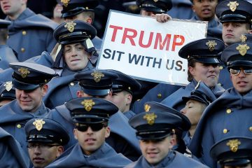 Photo of an Army cadet holding a sign for President Donald Trump