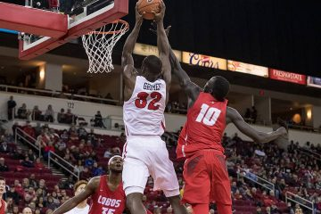 Photo of Fresno State's Nate Grimes going for a dunk