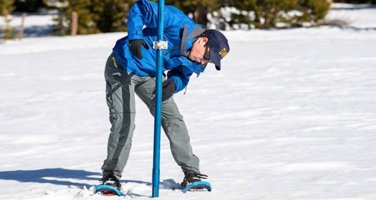 Photo of worker taking snow survey at Phillips Station, California