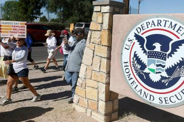 Photo of protesters walking outside the El Paso Processing Center