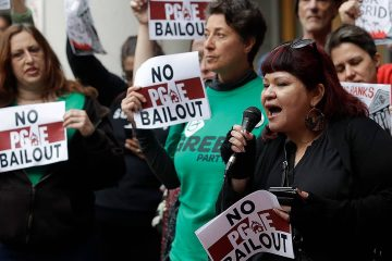 Photo of protesters before a California Public Utilities Commission meeting in San Francisco