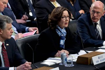 Photo of Gina Haspel accompanied by FBI Director Christopher Wray and Director of National Intelligence Daniel Coats