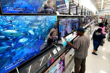 Photo of shoppers looking at televisions
