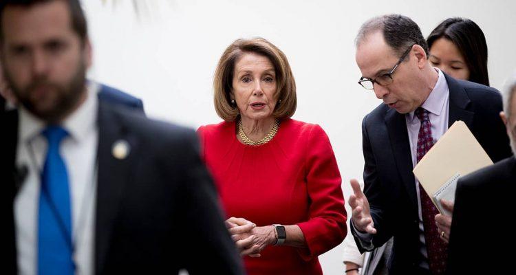 Photo of Nancy Pelosi leaving House Democratic caucus meeting
