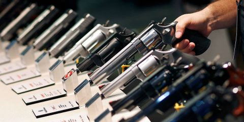 Photo of handguns displayed at the Smith & Wesson booth at the Shooting, Hunting and Outdoor Trade Show in Las Vegas
