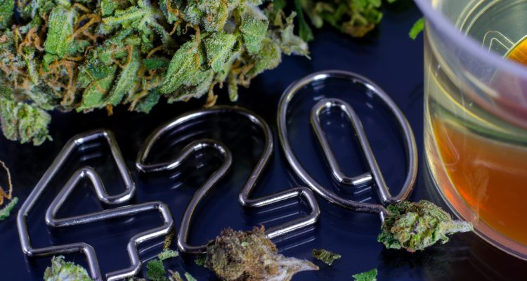 Image of marijuana bud, cannabis oil and the numbers 420