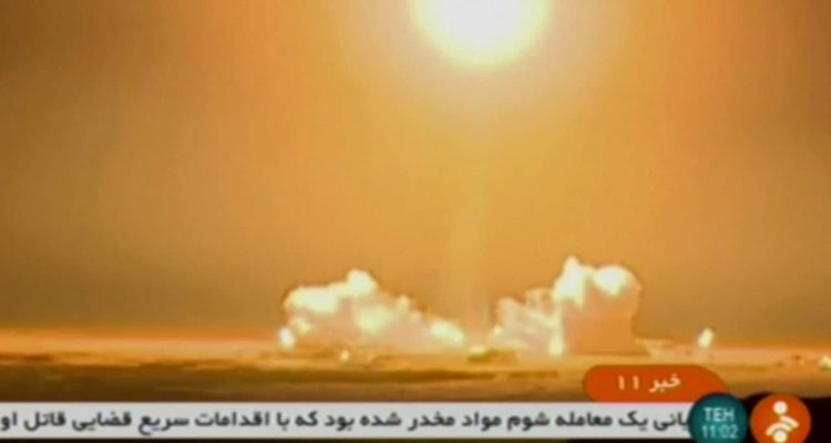 Photo of a rocket carrying a Payam satellite from an Iranian state TV screen grab