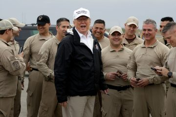Photo of President Trump with customs and border agents