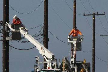 Photo of utility crews repairing overhead lines along the PCH