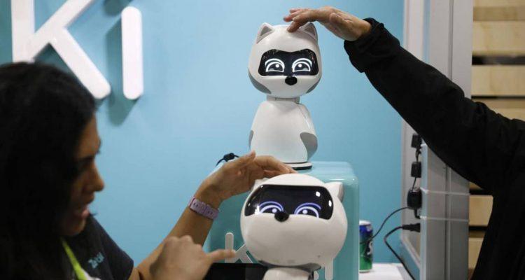 Photo of people touching Kiki robots