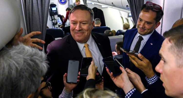 Photo of Mike Pompeo talking to reporters