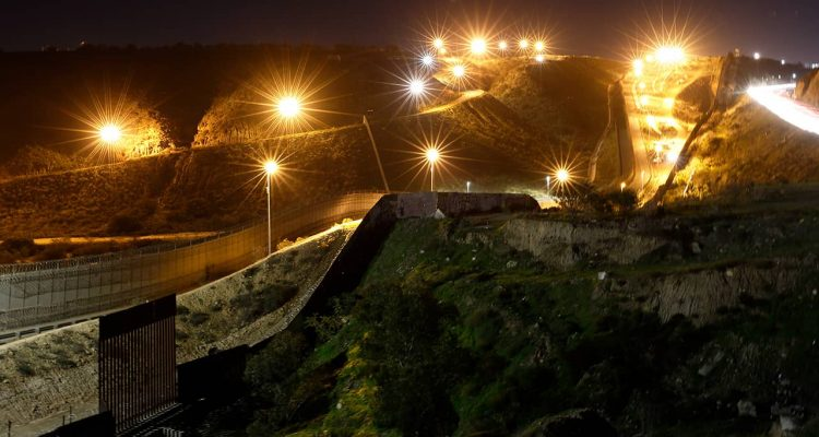 Photo of floodlights illuminating border walls