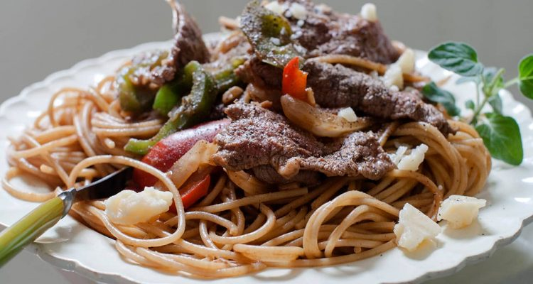 Photo of a dish of steak and cheese pasta