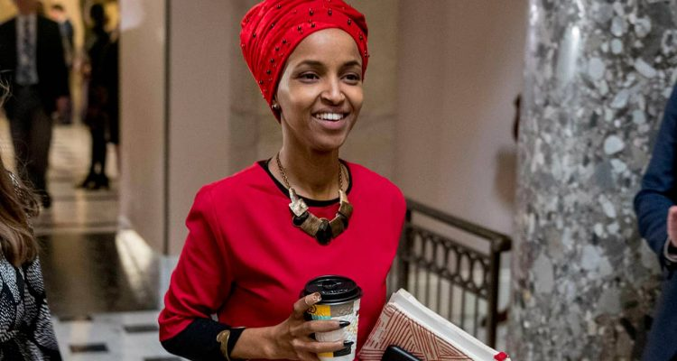 Picture of Rep. Ilhan Omar walking through the halls of the Capitol.