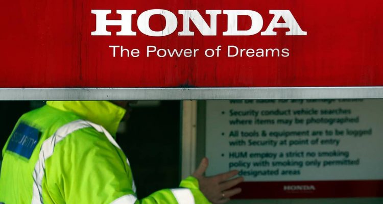Photo of security guards at the entrance of a Honda car plant in Swindon