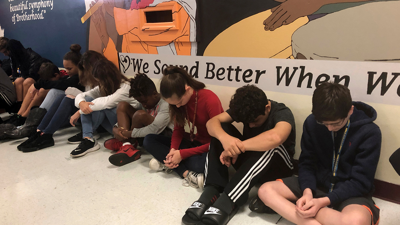Photo of students taking a moment of silence