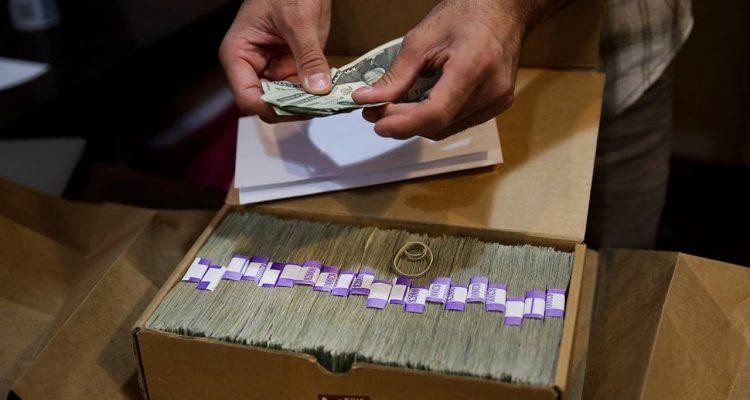 Photo of money from medical marijuana dispensary