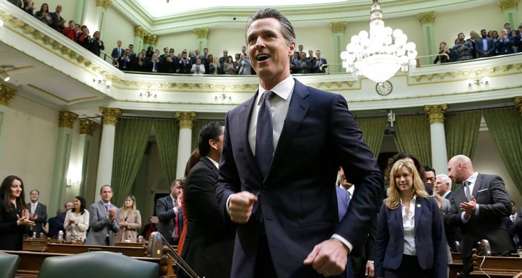 Gov. Gavin Newsom enters the Capitol chamber