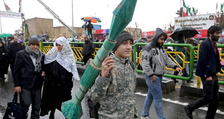 Photo of teenager carrying a mock rocket propelled grenade