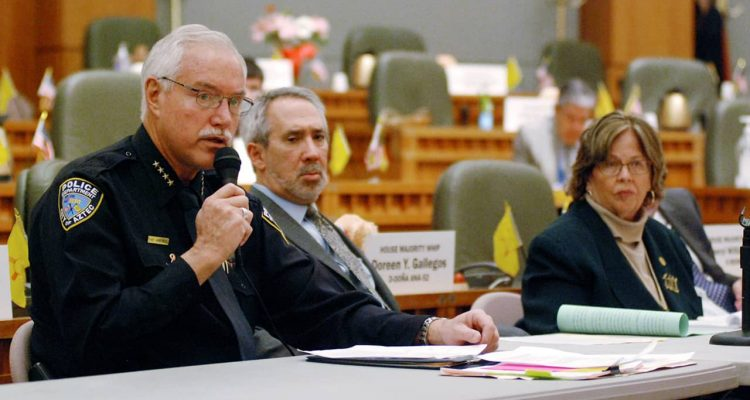 Photo of Mike Heal, left, police chief for the city of Aztec, N.M.