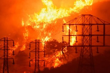 Photo of flames burning near power lines in Sycamore Canyon