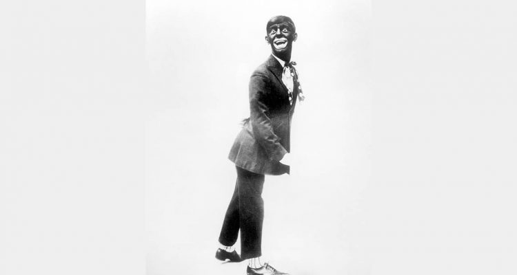 "Photo of Eddie Cantor wearing blackface while performing ""If You Knew Susie."""