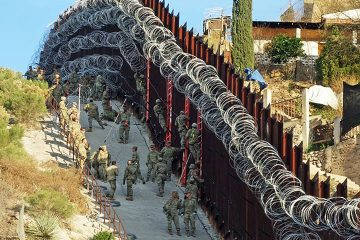 Photo of border wall in Arizona covered in razor wire