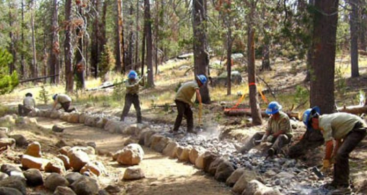 California Conservation Corps members improve a trail in Northern California