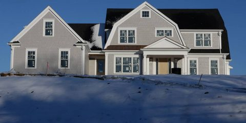 Photo of a home surrounded by snow in Natick, Mass.