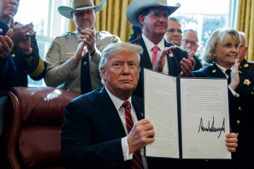 Photo of President Donald Trump after signing his first veto in the Oval Office