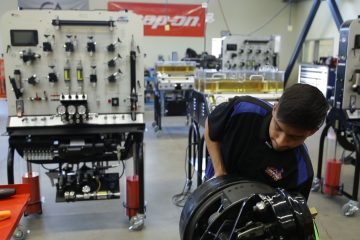 A photo of Duncan Poly student Enoc Lopez working in the school's new heavy maintenance facility