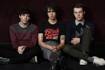 Photo of Braeden Lemasters, left, Cole Preston, center, and Dylan Minnette of the indie rock band Wallows