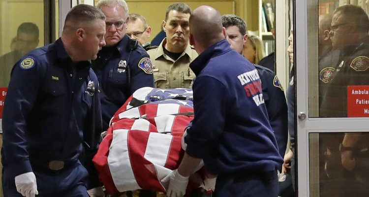 Photo of the body of a Kittitas County Sheriff's deputy draped with a US flag