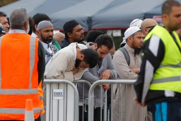 Photo of mourners attending service for a victim of the mosque shootings