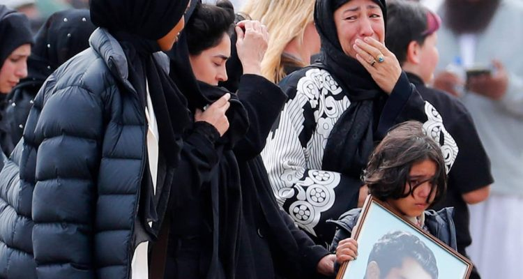 Photo of mourners arriving at a burial service