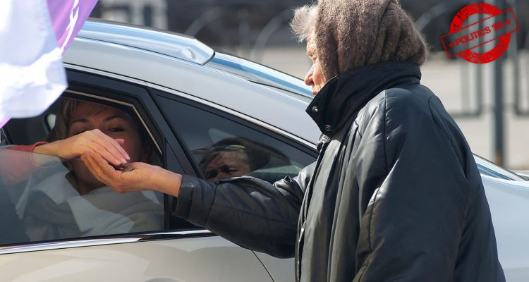 Photo of a woman receiving money from a person in a car