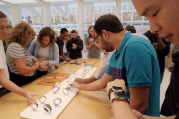 Photo of people looking at Apple Watches in New York