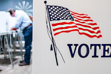Voter casts a ballot at local precinct in Fresno County during 2018 General Election