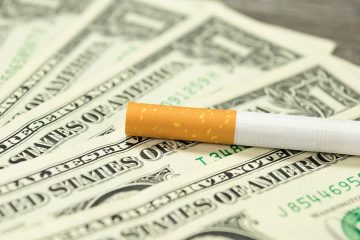 Photo of cigarette and money
