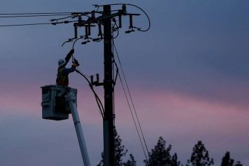 Photo of PG&E line worker at sunset